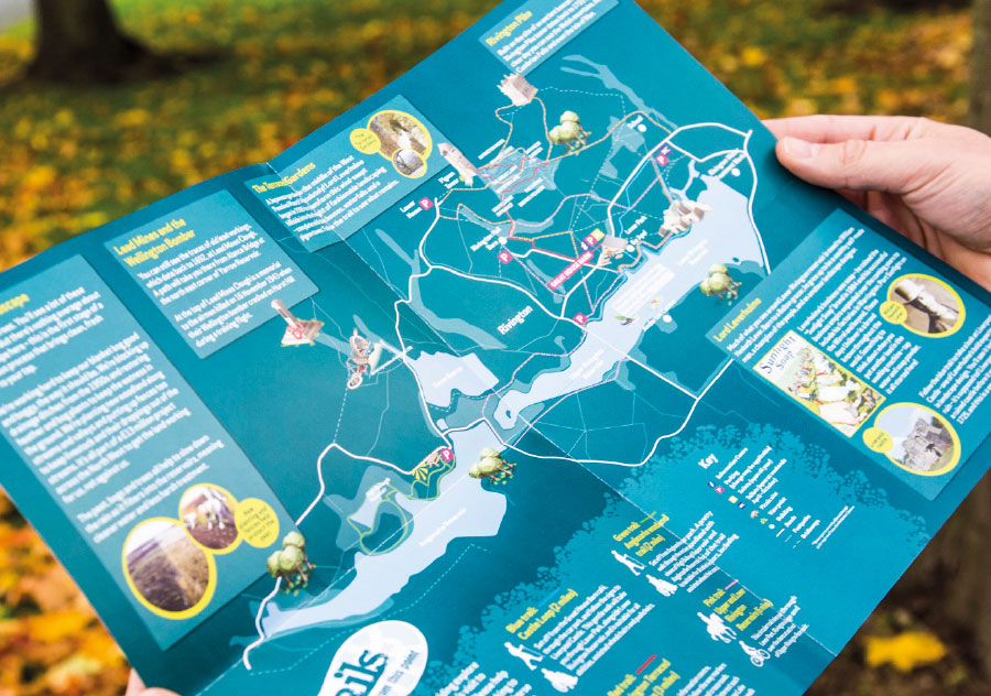 Information leaflet unfolded out to an A3 map showing the features and areas of interest around a lake.