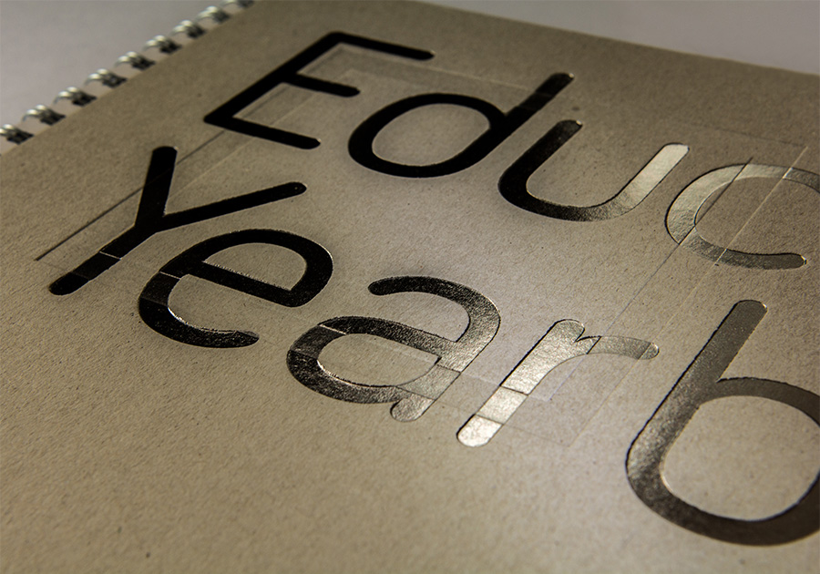 Education Yearbook front cover. Headline is a foil embossed silver finish.